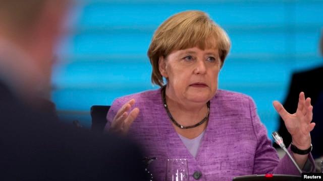 FILE - German Chancellor Angela Merkel in Berlin, July 3, 2013.