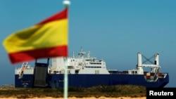 Saudi cargo ship Bahri-Yanbu passes a Spanish flag while departing the port of Santander, Spain, May 13, 2019.