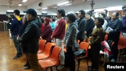 FILE - About 200 Catholics attend a prayer meeting for the Chinese Church after news emerge that Beijing and the Vatican have reached a deal on bishop appointments, in Hong Kong, China, Feb. 12, 2018.