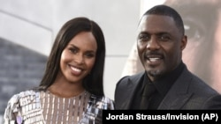 "FILE - Idris Elba his wife Sabrina Dhowre Elba are seen here in a July 13, 2019 file photo. Elba says he and his wife had their lives ""turned around"" after contracting the coronavirus. (Photo by Jordan Strauss/Invision/AP, File)"