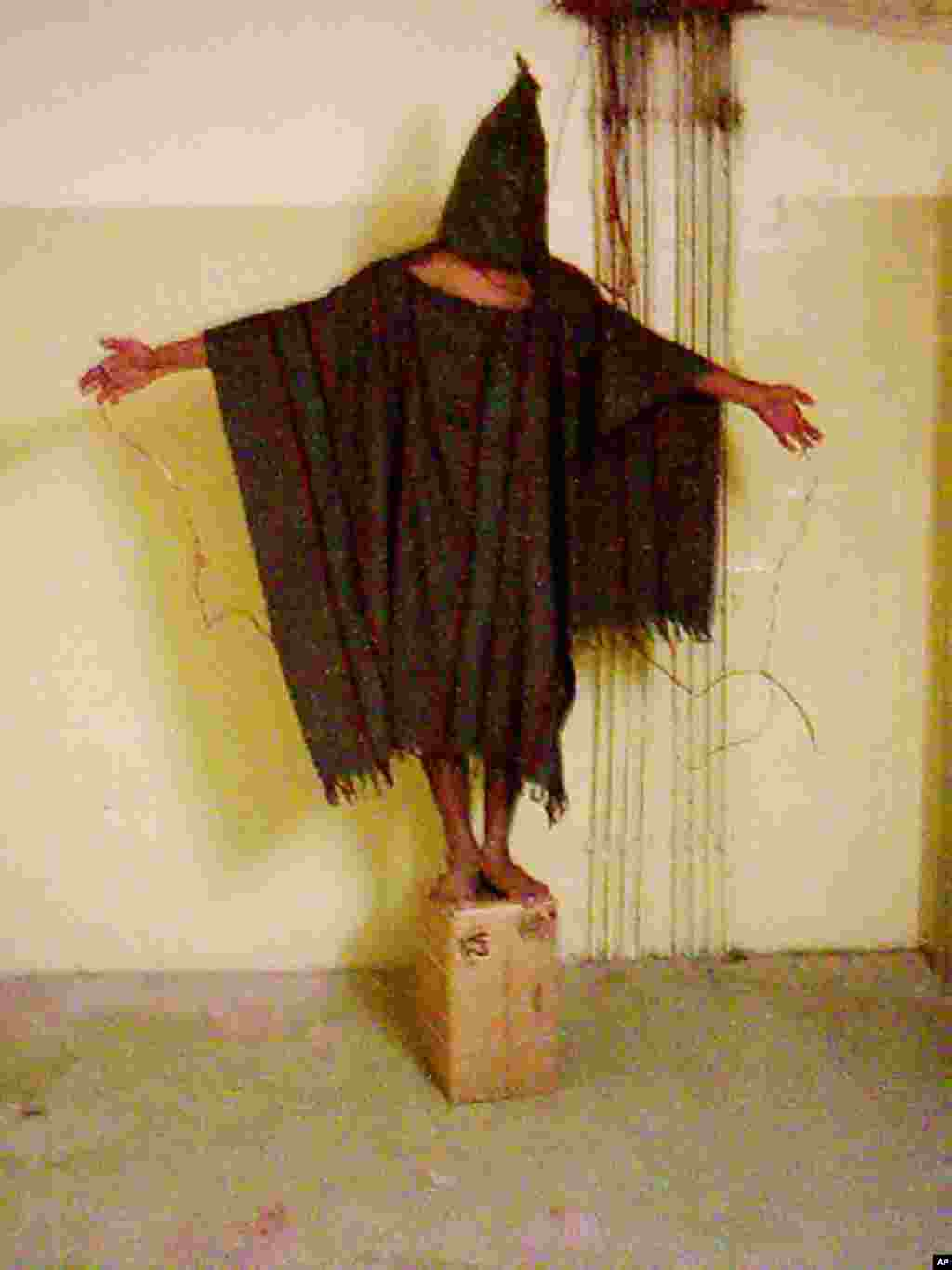 This image obtained by The Associated Press shows an unidentified detainee standing on a box with a bag on his head and wires attatched to him in late 2003 at the Abu Ghraib prison in Baghdad, Iraq.