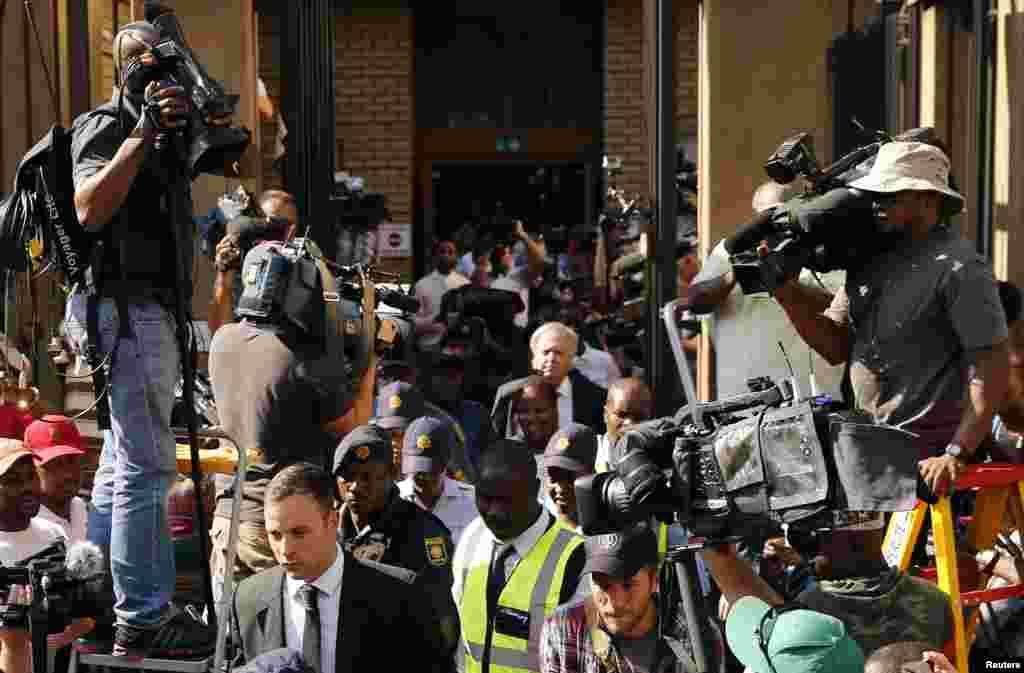 Oscar Pistorius leaves the North Gauteng High Court in Pretoria, Oct. 14, 2014.