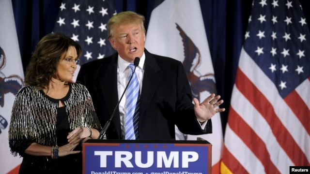 FILE -  US Republican presidential candidate Donald Trump (R) thanks the crowd after receiving Former Alaska Gov. Sarah Palin's endorsement at a rally at Iowa State University in Ames, Jan. 19, 2016.