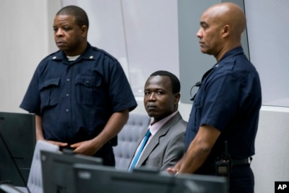 FILE - Dominic Ongwen, center, a senior commander in the Lord's Resistance Army, whose fugitive leader Kony is one of the world's most-wanted war crimes suspects, sits in the court room of the International Court in The Hague, Netherlands, Dec. 6, 2016.