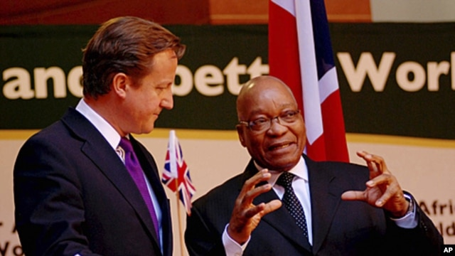 British Prime Minister David Cameron talks with South African President Jacob Zuma (R) as they attend a media conference in Pretoria in this handout picture, July 18, 2011