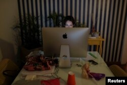 Danielle de Angelis works from home during a lockdown imposed by the state government because of the coronavirus disease (COVID-19) outbreak in Santo Andre, Brazil, March 26, 2020.