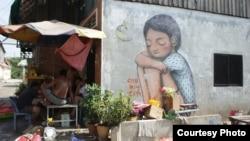 Graffiti in the Boeung Kak community, Phnom Penh, Cambodia. (Courtesy of Sorita Heng)