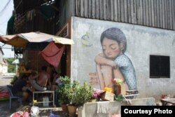 Graffiti in Boeung Kak area in Phnom Penh. (Courtesy of Sorita Heng)