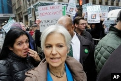 FILE - Jill Stein, the presidential Green Party candidate, arrives for a news conference in front of Trump Tower, Dec. 5, 2016, in New York.
