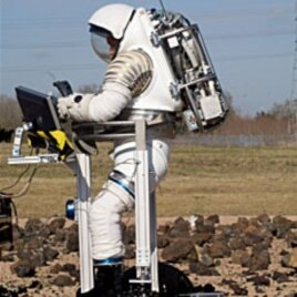An astronaut tests a Mark III space suit designed for the Constellation program in 2007