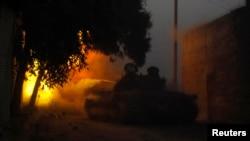 A Free Syrian Army tank fires a shell towards forces loyal to President Bashar Al-Assad in Aleppo, Nov.30, 2013.