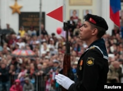A sailor stands during a Victory Day military parade in Sevastopol, Crimea on May 9, 2014.