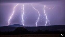 In this photo taken Wednesday, Aug. 9, 2017 a strike of lightning illuminates the sky over Annaberg-Buchholzer, southeastern Germany. (Bernd Maerz/dpa via AP)