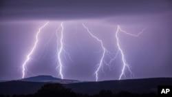 In this photo taken Aug. 9, 2017 a strike of lightning lights up the sky over Annaberg-Buchholzer, southeastern Germany. (Bernd Maerz/dpa via AP)