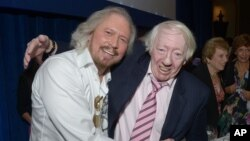Barry Gibb of the Bee Gees, left, and Robert Stigwood, the former Bee Gees manager, on June 28, 2013, in London.