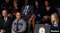 U.S. Vice President Joe Biden, bottom left, Baton Rouge Police Chief Carl Dabadie Jr., center, and U.S. Attorney General Loretta Lynch, top right, listen to Tonja Garafola, widow of East Baton Rouge Sheriff's Deputy Brad Garafola, during a memorial service for three slain Baton Rouge-area police officers at Healing Place Church in Baton Rouge, Louisiana, July 28, 2016.