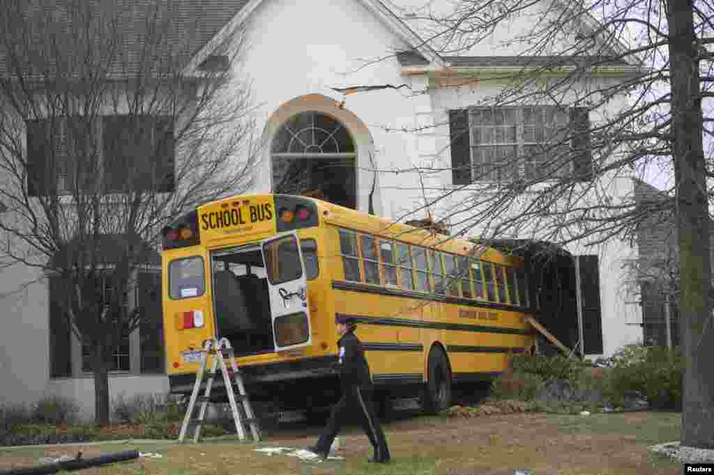 A school bus is seen after it crashed into a house at the Windermere Development in Blue Bell, Pennsylvania. The school bus carrying nine elementary school students careened off the road and crashed into a home in suburban Philadelphia home. According to police, no injuries were reported.
