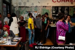 Attendees mingling at the first Black Iftar event, held in Chicago and hosted by Samira Abderahman.