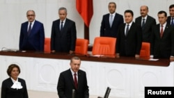 Turkey's new President Tayyip Erdogan (front C) attends a swearing in ceremony at the parliament in Ankara, August 28, 2014.
