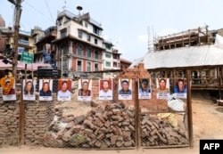 Portraits of victims are seen at the reconstruction site of Kathmandu's Durbar Square which was damaged by a 2015 earthquake, on the fourth anniversary of the disaster in Kathmandu, April 25, 2019.