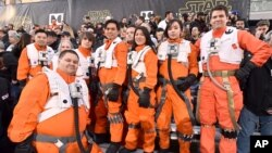 """Fans dressed in character wait in the stands at the world premiere of """"Star Wars: The Force Awakens"""" at the TCL Chinese Theatre on Monday, Dec. 14, 2015."""