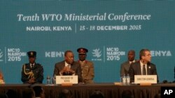 Director General of the World Trade Organisation, Roberto Carvalho, right, the Liberian President, Johnson Sirleaf, left, and Kenyan President, Uhuru Kenyatta, center, during the official opening of the Tenth WTO Ministerial Conference in Nairobi, Kenya,