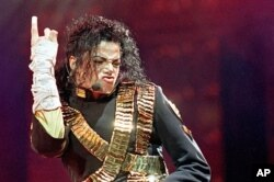 "FILE - In this Aug. 25, 1993 file photo, American pop star Michael Jackson performs during his ""Dangerous"" tour in Bangkok."