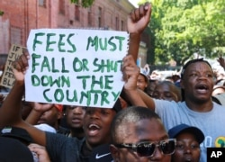 FILE - Students protest university fee hikes at a rally in Cape Town, South Africa, Oct. 22, 2015.