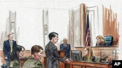Alleged Russian spy suspects Patricia Mills and Michael Zottoli are seated (left foreground) in US federal court , 02 Jul 2010