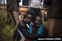 The sister of Duku Evans — who was killed November 3 amid fighting between government troops and rebels in Logo displaced persons camp in Kajo Keji, South Sudan — wails as the casket containing her brother's body is carried by at his funeral on the Ugandan border, Nov. 5, 2017.