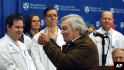 Del Peterson, grandfather of face transplant recipient Dallas Wiens, turns and gives thumbs up to the surgical team during a news conference at Brigham and Women's Hospital in Boston, March 21, 2011