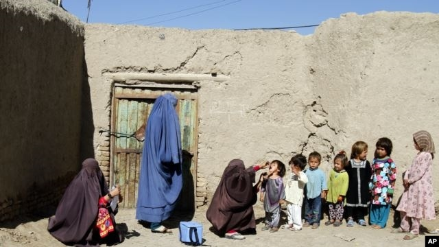 FILE - Afghan children are being vaccinated in an Afghan province.