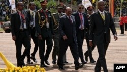Sudan's President Omar al-Bashir (C) attends the swearing-in ceremony of Uganda's President Yoweri Museveni as newly elected President in Kampala on May 12, 2016.