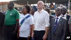 FIFA's new president, Gianni Infantino, at center-right, stands with South Sudan's Vice President James Wani Igga, right, before a match between South Sudan and Benin, in Juba, March 23, 2016. Infantino came to help open the South Sudan Football Association at a time when the young country's government is struggling for funds due to a drop in worldwide oil prices and an expensive civil war that is in its third year.