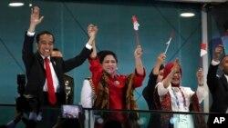 Presiden Joko Widodo dan Ibu Negara di pembukaan Asian Games 2018.