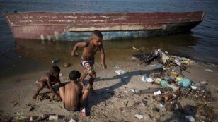 Children playing on the shores of Guanabara Bay