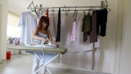 Gelia, a maid works in a condominium in Kuala Lumpur, Malaysia, Wednesday, June 17, 2009. At least two women have died in the custody of recruitment firms prior to scheduled departures for Malaysia.