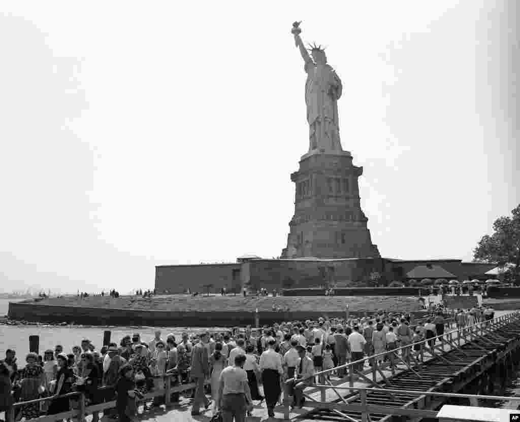 Visitors move toward the base of the Statue of Liberty on Bedloe's Island in New York's harbor on July 12, 1948.