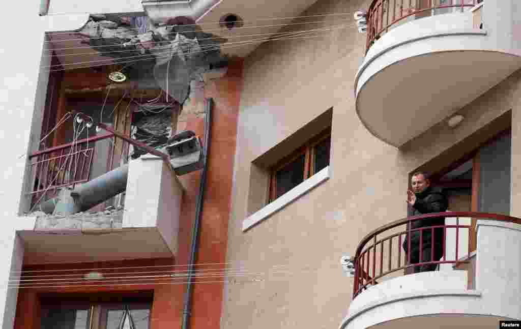 A balcony of a residential building is seen hit by a missile casing in Stepanakert in the region of Nagorno-Karabakh, Nov. 16, 2020.
