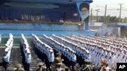 Iranian soldiers march during an annual military parade which marks Iran's eight-year war with Iraq, in the capital Tehran on 22 Sep 2010