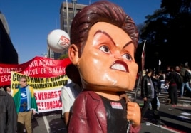 A striking worker carries a large effigy of Brazil's President Dilma Rousseff during a protest in Sao Paulo, Brazil, July 11, 2013.