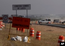 Workers leave the Ford construction site after they were sent home early the day after the U.S. auto company cancelled plans to build its plant in Villa de Reyes, Mexico, Jan. 4, 2017..