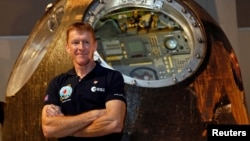 British astronaut Tim Peake poses before a news conference at the Science Museum in London, Nov. 6, 2015.