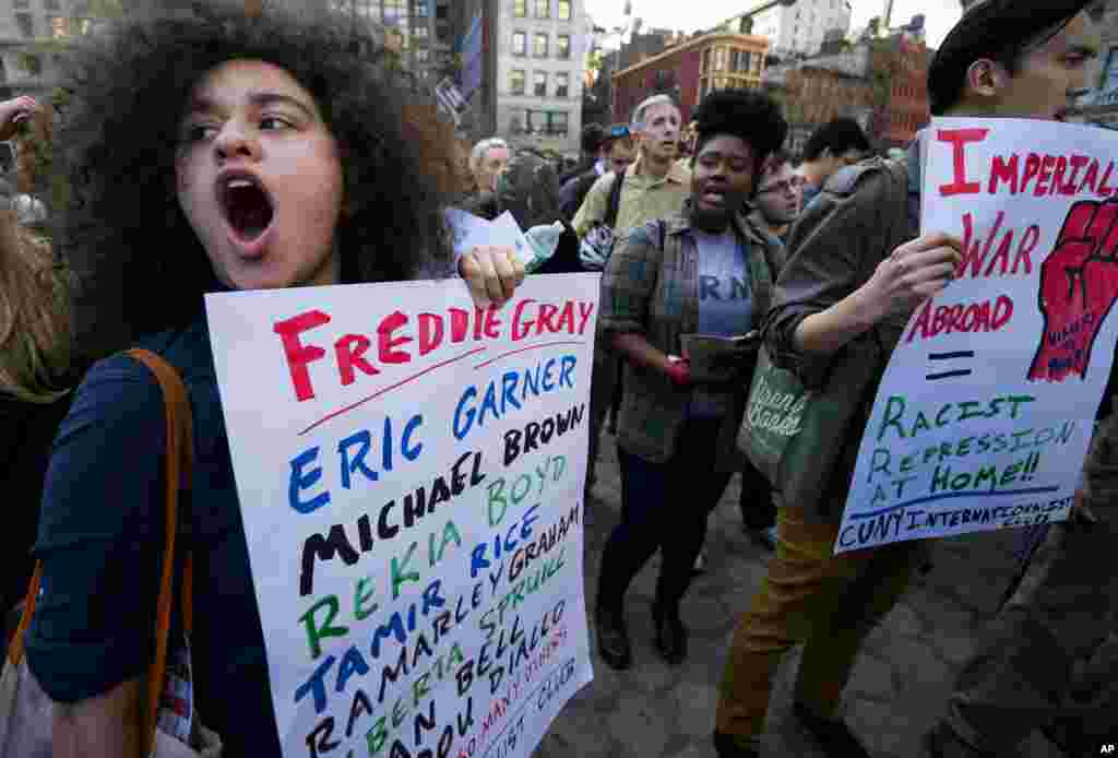 People yell out while gathered to protest the death of Freddie Gray, a Baltimore man who was mortally injured while in police custody, Union Square, in New York, April 29, 2015.