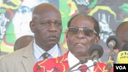 Zimbabwe President Robert Mugabe addressing members of his Zanu PF party at a football stadium in Lupane, about 600km south west of Zimbabwe's capital (S. Mhofu/VOA)