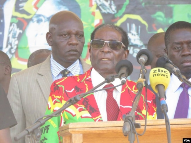 FILE - Zimbabwe President Robert Mugabe addressing members of his ZANU-PF party at a football stadium in Lupane, about 600km south west of Zimbabwe's capital (S. Mhofu/VOA)