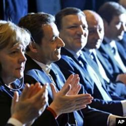 Angela Merkel,Nicolas Sarkozy e Durão Barroso