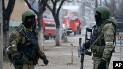 FILE - Russian special forces run an anti-terrorist operation in Makhachkala, Dagestan, Jan. 20, 2014. The North Caucasus province has been feeding fighters to IS, officials say; Elvira Karayeva, shot by IS, was from Karachaevo-Cherkessia in the North Caucasus.