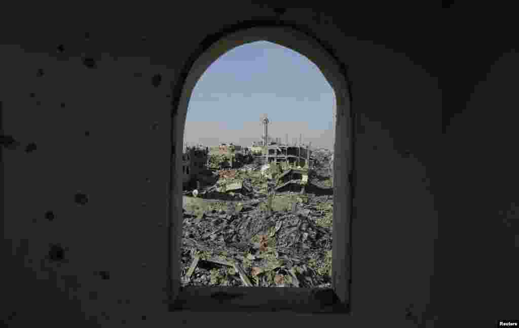 Destruction is pictured through the window of a mosque in Shejaia neighborhood, which witnesses said was heavily hit by Israeli shelling and airstrikes during an Israeli offensive, in the east of Gaza City, Aug. 1, 2014.