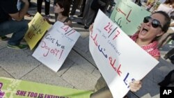 "Activists hold banners - one of which (R) reads, ""I am a worker, not a servant"" - during a demonstration to support the rights of migrant domestic workers in Lebanon, in Beirut, Lebanon, May 1, 2010 (file photo)"